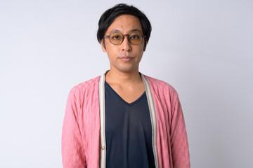 Portrait of Japanese man against white background