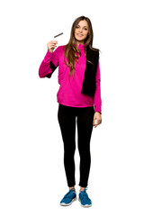 Full-length shot of Young sport woman making a selfie over isolated white background