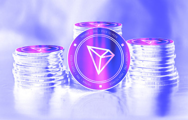 Tronix (TRX) digital crypto currency. Stack of coins. Cyber money.