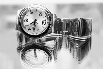 photo of a wrist watch in black and white