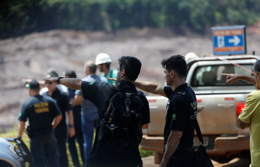 Federal police officers are seen at the collapsed Brazilian mining company Vale SA, in Brumadinho