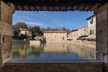 View of the thermal and medieval hamlet of Bagno Vignoni, Siena, Tuscany, Italy