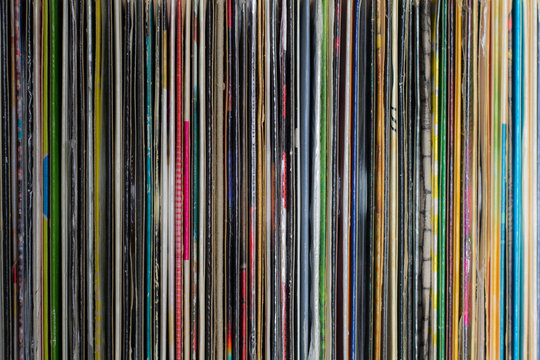 Stack of old vinyl records background