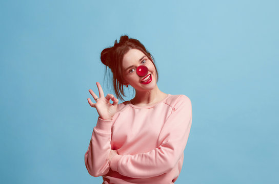 The happy surprised and smiling woman on red nose day. The clown, fun, party, celebration, funny, joy, holiday, humor concept