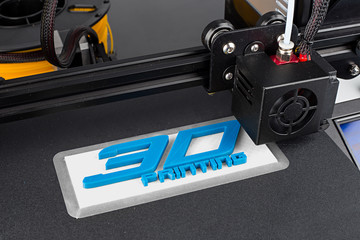 3d printer printing logo symbol with white blue pla filament science technology future hobby concept