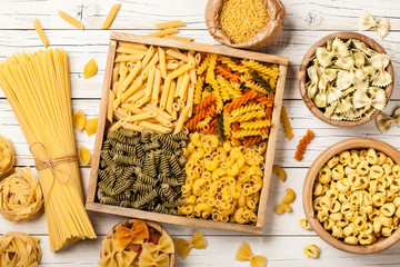 Assortment of pasta on wooden table