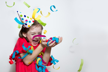 Birthday. Holiday, baby red dress on white background. Celebrates a bright event. Have fun-image