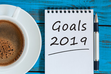 2019 goals text on desk table office Top view, flat lay. Targets, goal, dreams and expectation for the next year