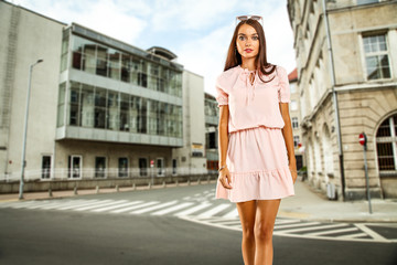 woman in pink dress and city background