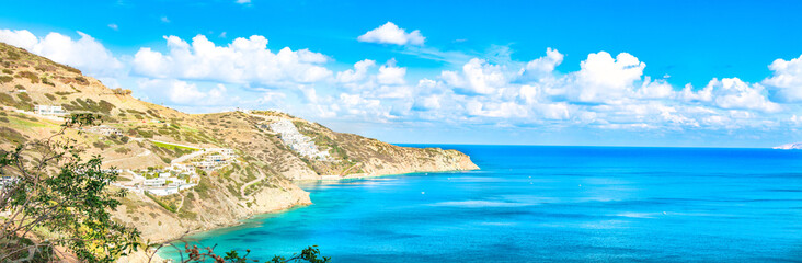 Beautiful Panorama with turquoise sea. View of Theseus Beach, Ammoudi, Crete, Greece. HD landscape, blue sky and mountains.