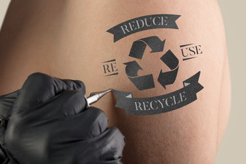 Hand tattooing recycle for a better environment concept on naked clear skin