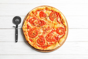 Hot cheese pizza Margherita on white wooden background, top view