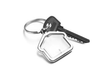 House key with trinket on white background