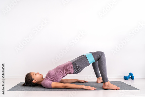 Resistance hoop band exercises Fit girl training on floor