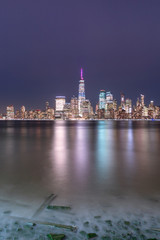 View on Financial district at night from Hudson river beach with long exposure