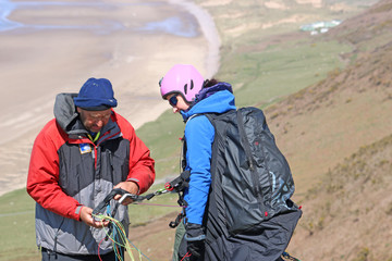 Paraglider preparing to launch at Rhossili