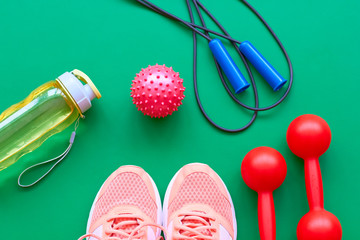 Sneakers, jump rope and water bottle. Morning fitness.