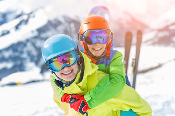 Skiing, winter, snow, sun and fun - kids, boy and girl having fun in the Alps. Child skiing in the mountains.