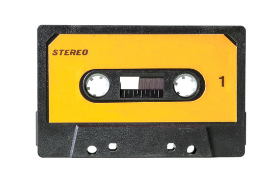An old vintage cassette tape from the 1980s (obsolete music technology). Black plastic body, canary yellow label with the texts Stereo and 1 (one).