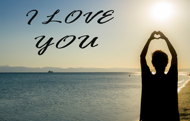 I love you, Happy Valentine's Day concept. Beautiful woman making heart sign. Girl hands in form of heart shape symbol. Happiness, feelings, holiday, magic, falling in love conceptual photo.