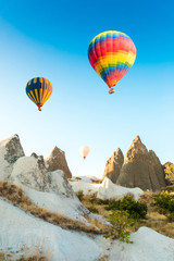 Foto op Canvas Ballon Colorful hot air balloons flying over at fairy chimneys in Nevsehir, Goreme, Cappadocia Turkey. Hot air balloon flight at spectacular Cappadocia Turkey.