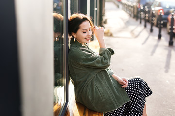 Pretty girl sit outside office smile to camera and feeling good