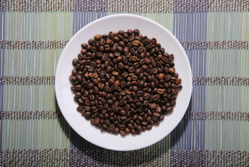 A scattering of coffee beans on a plate.