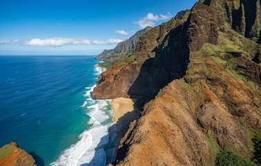 Aerial view of Na Pali coastline and landscape of hawaiian island of Kauai from helicopter flight