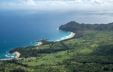 Aerial view of Kawelikoa Point and landscape of hawaiian island of Kauai from helicopter flight