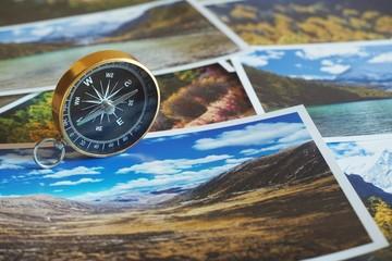 Compass on blur photograph of popular tourist destination background, traveling destination plan concept