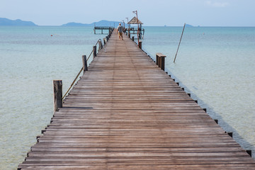 Wooden walkway that lead to the sea from the beach in summer in Koh Mak Island at Trat, Thailand.