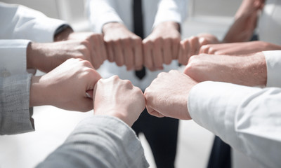 close up. business team forming a circle, out of their fists