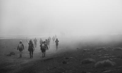 people walking on fog