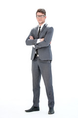 in full growth. young businessman with glasses