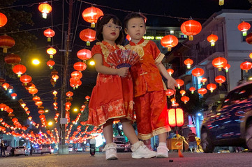 Children pose for a Lunar New Year picture in the street in Chinatown, Yangon