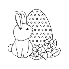 cute rabbit with easter egg painted in the garden