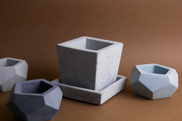 set of concrete pots,  trendy element of  modern interior design