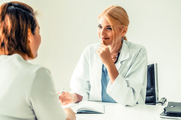 Female patient visits woman doctor or gynecologist during gynaecology check up in office at the hospital. Gynecology healthcare and medical service.
