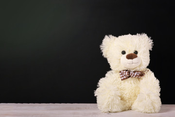Teddy bear near blackboard. Valentines Day background.