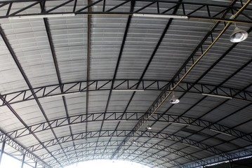 Large steel roof ..With strong sunlight reflected in the back.
