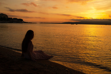 silhouette of a woman at sunset