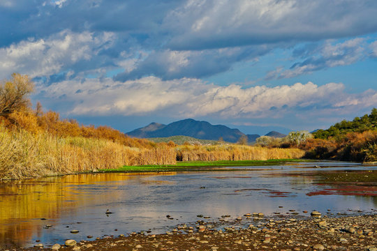 River Landscape with Mountains