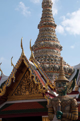 Bangkok Thailand, Giant guardian at the Grand Palace and Wat Phra Kaew with ornately decorated chedi in background