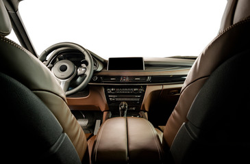 Modern luxury car Interior - steering wheel, shift lever and dashboard. Car interior luxury inside. Steering wheel, brown perforated leather cockpit