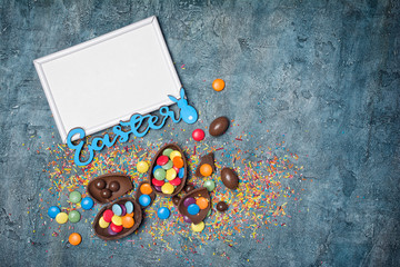 Mock up of blank white frame with blue text of easter and traditional sweeties