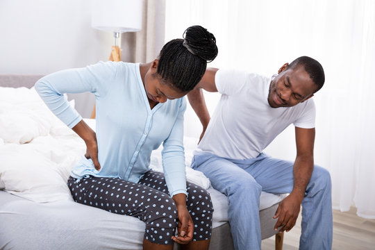 Couple Suffering From Back Pain