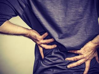 Man having back loins pain ache