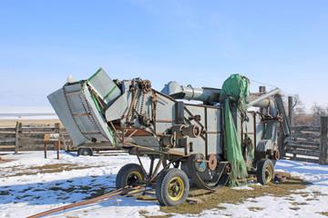 Vintage combine harvester in winter