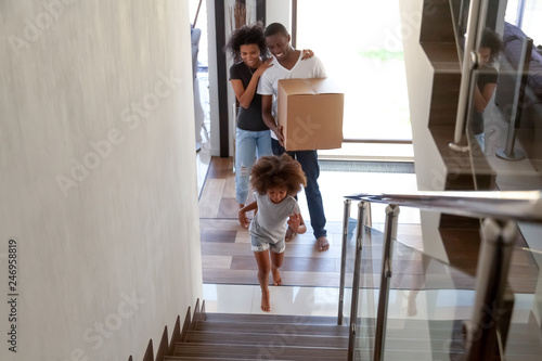 Cute African American Child Girl Running Up Stairs Exploring New Big