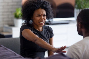 Abused angry scared african wife victim shows stop enough violence hand gesture, unhappy black woman afraid of fight with husband feels desperate about aggression, bad relationships, family conflict